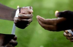 1426800669children-lighting-candles-at-amahoro-Stadium-during-the-Kwibuka-commemoration