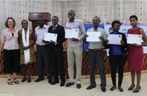 Umugiraneza (fourth left) poses for a picture with other contestants and Survivors Fund officials after the awards function on Monday. Umugiraneza bagged this year's Innovation Entrepreneurship Award worth Rwf5m in funding. (Solomon Asaba)
