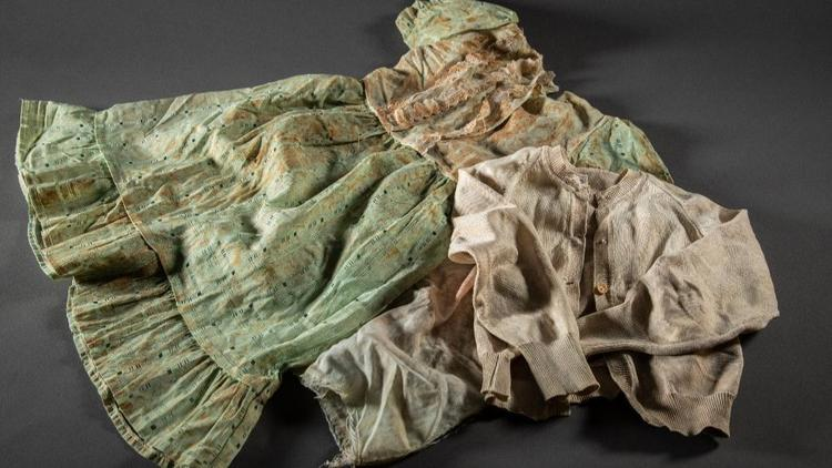 Clothing of sisters Clarisse and Raissa recovered from a grave in Rwanda and donated by their mother Immaculee Mukantaganira